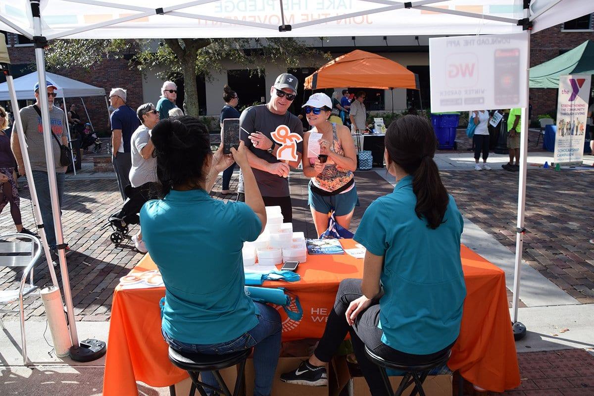 healthy wet orange tent with people