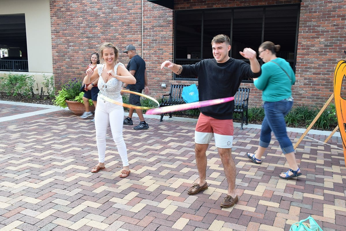 woman and man hula hooping
