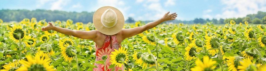 woman outside in sunflower field