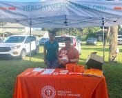 health west orange tent with HWO team