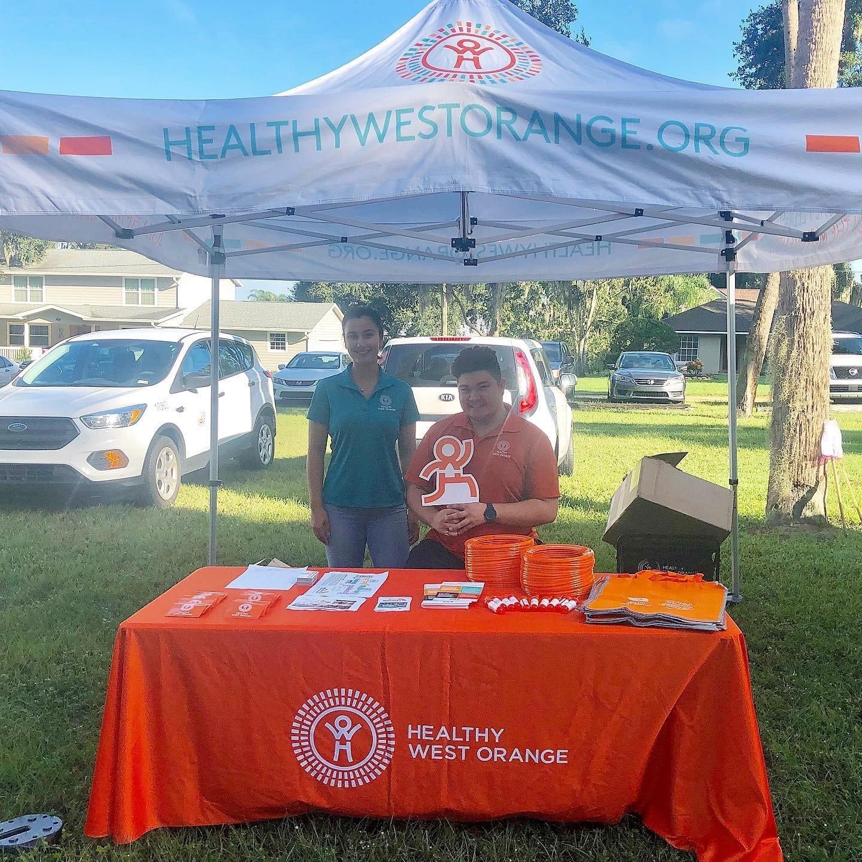 health west orange tent with HWO team