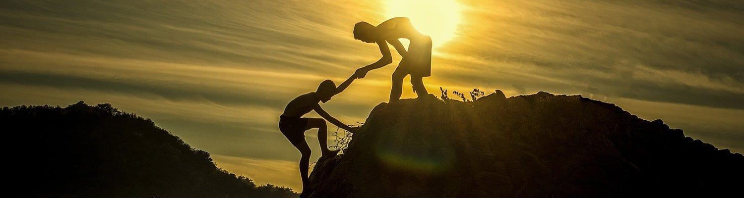 Climbers helping each other