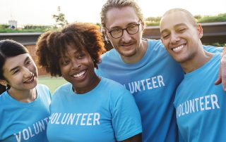 group of four volunteers